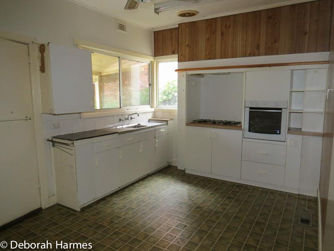 Crumbling and dated kitchen.