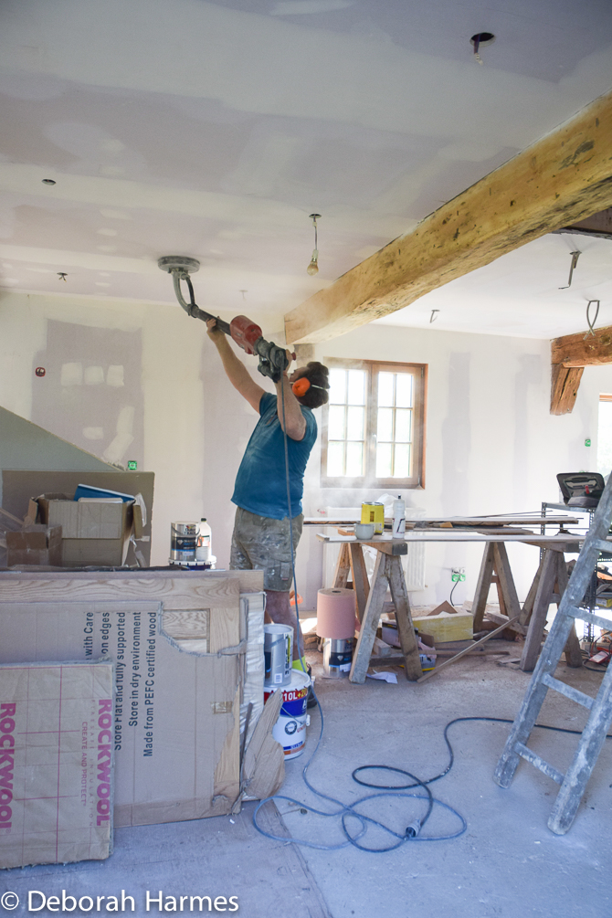 Mark doing overhead sanding on the new ceilings -- April 2017.