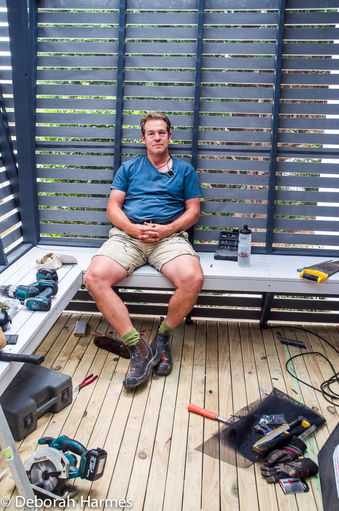 Mark taking a much deserved breather inside the lovely timber-slatted screen entry porch.
