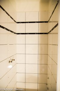 Newly installed tiles in one of the 4 upstairs bathrooms.