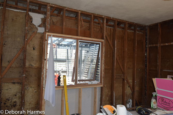 Walls gutted of old and thin 1950 plasterboard.